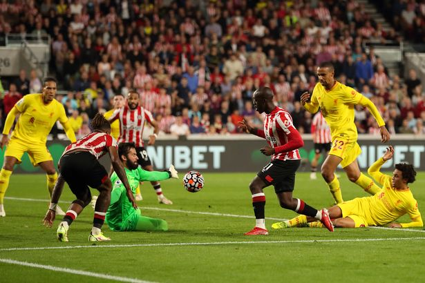Yoane Wissa of Brentford scores a goal to make it 3-3 during the Premier League match between Brentford and Liverpool at Brentford Community Stadium on September 25, 2021 in Brentford, England.