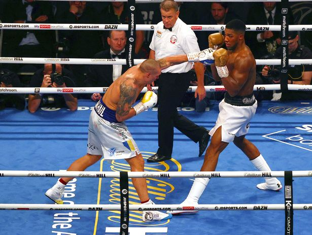 Ukrainian boxer Oleksandr Usyk (L) fights British heavyweight champion boxer Anthony Joshua at the end of their heavyweight boxing match at Tottenham Hotspur Stadium in north London on September 25, 2021. - Usyk defeated Joshua on points.