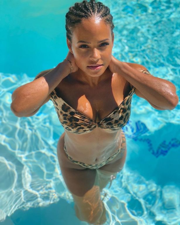 Feline sexy in the pool as she takes a quick dip