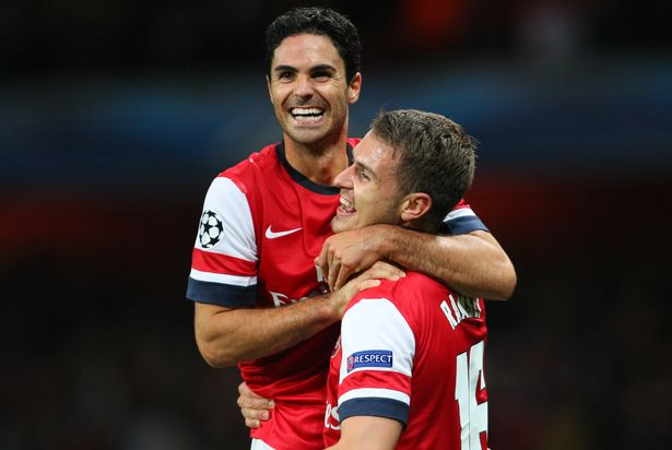 Mikel Arteta of Arsenal celebrates with Aaron Ramsey of Arsenal after Ramsey scores to make it 3-1