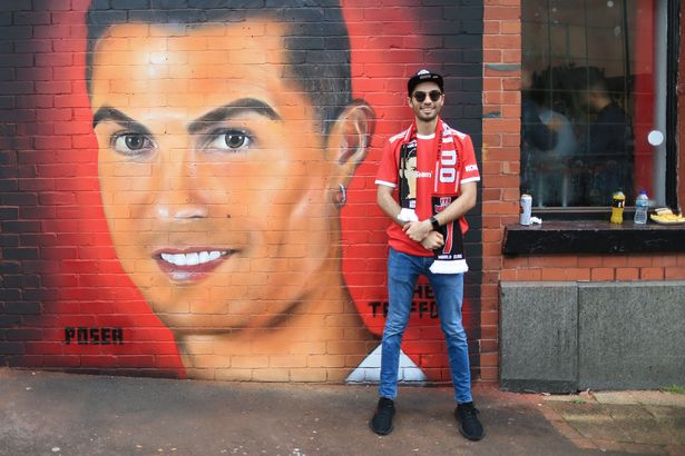 Despite similarities to Pat Butcher, some fans still took the opportunity to pose next to the strange mural