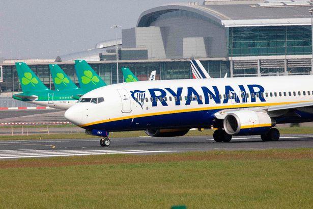 A Ryanair plane taxis at an airport