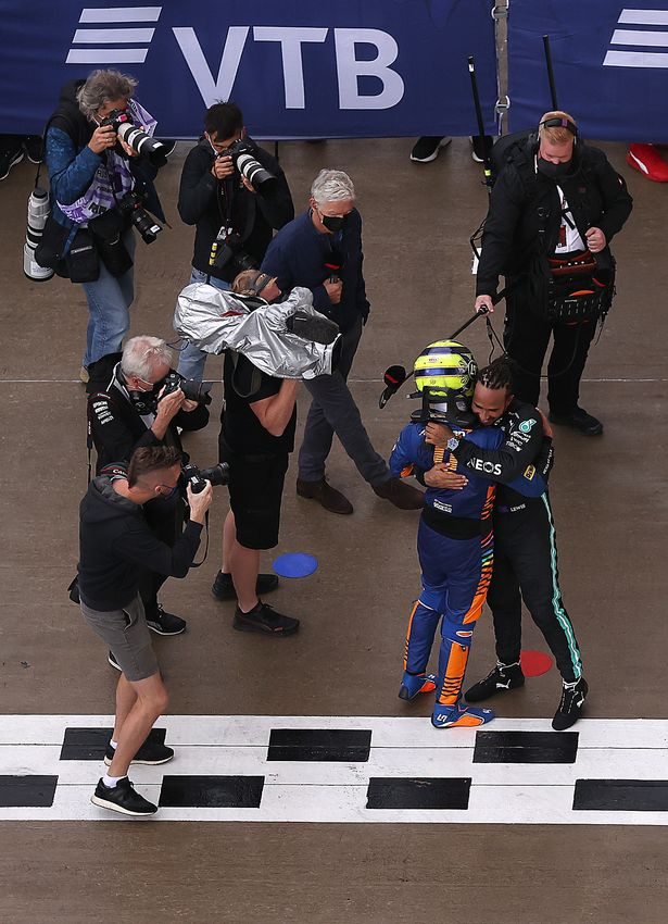 Lando Norris hugs Lewis Hamilton