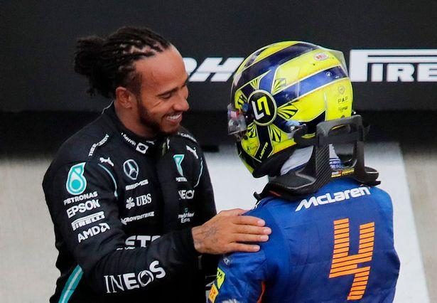 Lewis Hamilton and Lando Norris embrace