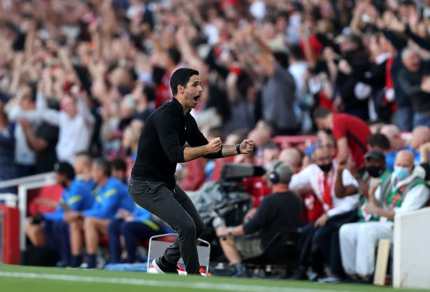 Mikel Arteta, Manager of Arsenal celebrates their side's third goal scored by Bukayo Saka of Arsenal (not pictured) during the Premier League match between Arsenal and Tottenham Hotspur at Emirates Stadium on September 26, 2021