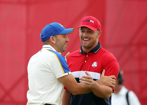 Bryson DeChambeau of team United States and Sergio Garcia of Spain and team Europe react on the 15th green during Sunday Singles Matches of the 43rd Ryder Cup at Whistling Straits on September 26, 2021 in Kohler, Wisconsin