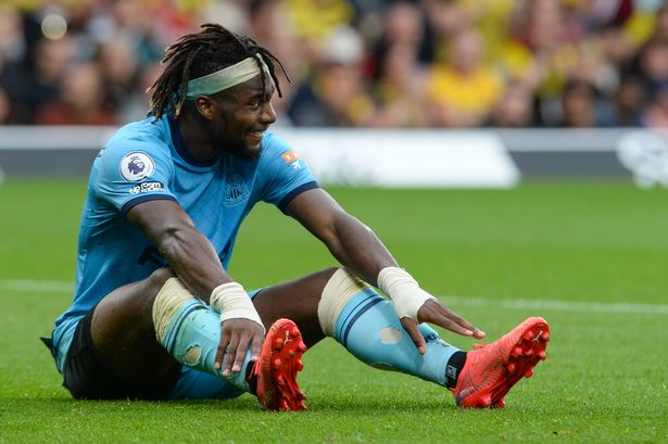 Allan Saint-Maximin of Newcastle United FC #10 sits on the grass during the Premier League match between Watford and Newcastle United at Vicarage Road on September 25, 2021 in Watford, England.