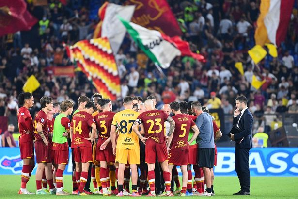 AS Roma's Portuguese coach Jose Mourinho (C) talks with his players at the end the Italian Serie A football match Lazio vs AS Roma at the Olympic stadium in Rome on September 26, 2021.