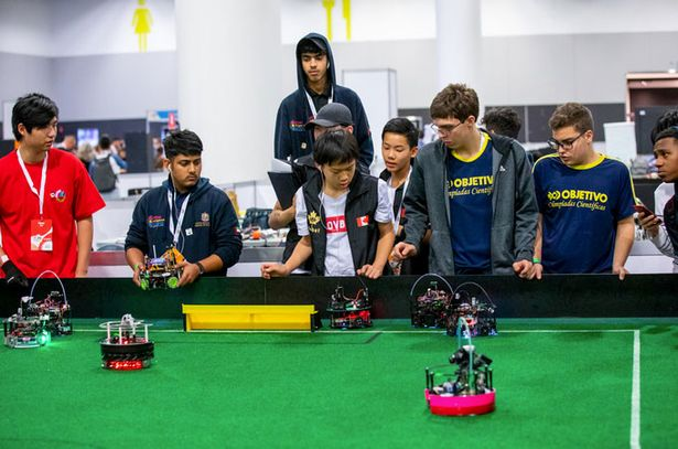At the Robocup teams design and build their own footballer bots
