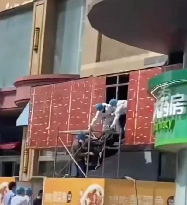 Police believed the woman might have fallen from heights and landed inside the billboard
