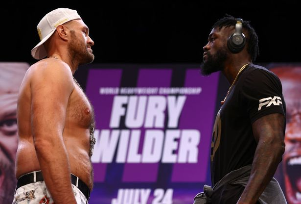 WBC Heavyweight Champion Tyson Fury (L) and Deontay Wilder (R) face-off during the press conference for the WBC heavyweight championship at The Novo by Microsoft at L.A. Live on June 15, 2021 in Los Angeles, California.