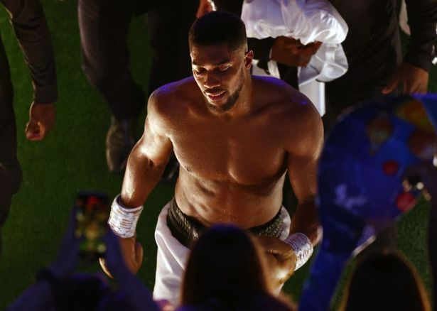 British heavyweight champion boxer Anthony Joshua leaves the arena after losing to Ukrainian boxer Oleksandr Usyk during their heavyweight boxing match at Tottenham Hotspur Stadium in north London on September 25, 2021. - Usyk defeated Joshua on points.
