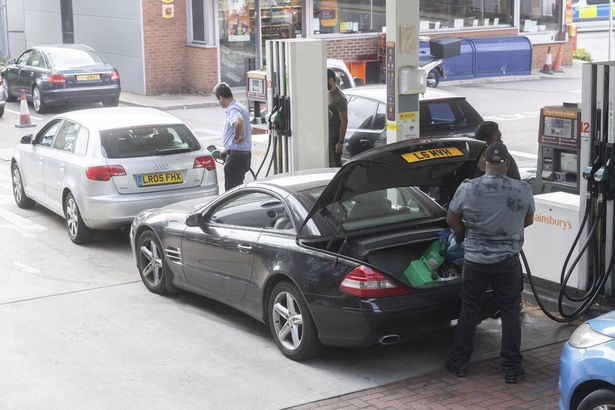 Motorists fill up their vehicles