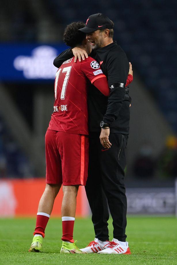 Jones receives an embrace from Jurgen Klopp after the final whistle