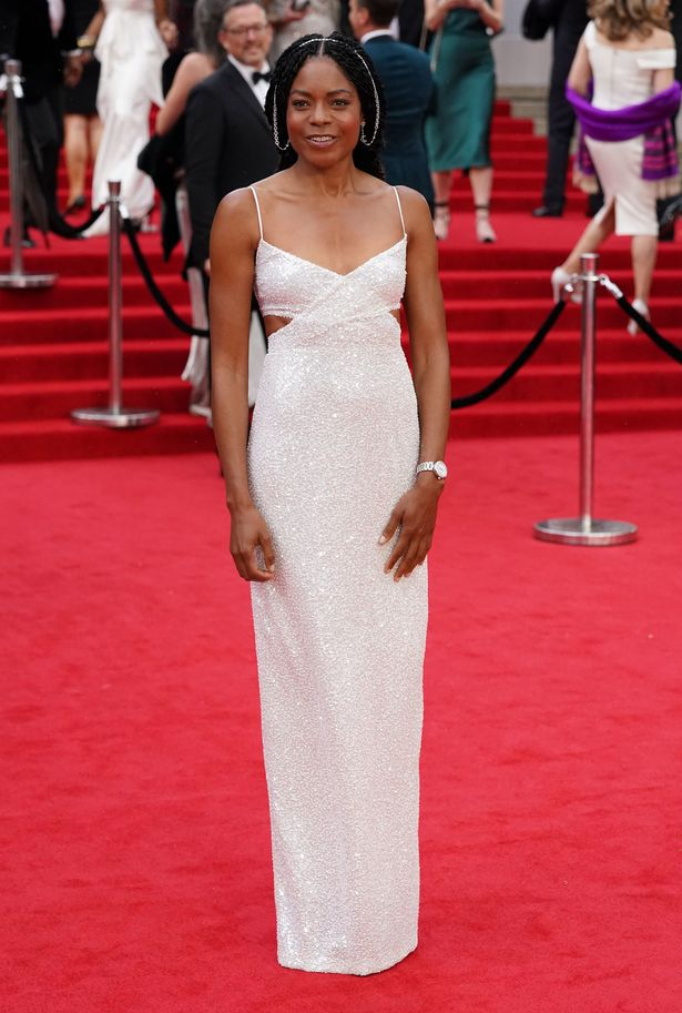 Naomi wowed in white as she debuts her third reprisal of Moneypenny in the new Bond flick
