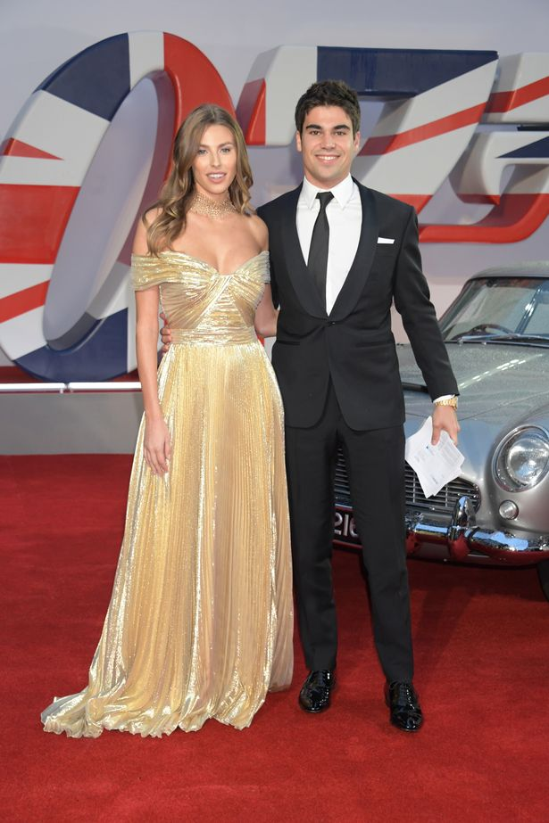 Italian model Sara Pagliaroli was joined by boyfriend Lance Stroll at the premiere. The model looked stunning in a gold off-the-shoulder gown