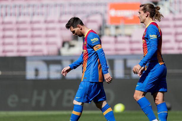 (L-R) Lionel Messi of FC Barcelona, Antoine Griezmann of FC Barcelona during the La Liga Santander match between FC Barcelona v Atletico Madrid at the Camp Nou on May 8, 2021 in Barcelona Spain