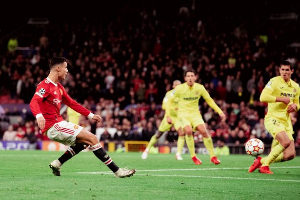 Cristiano Ronaldo of Manchester United scores a goal to make the score 2-1 during the UEFA Champions League group F match between Manchester United and Villarreal CF at Old Trafford on September 29, 2021 in Manchester, United Kingdom