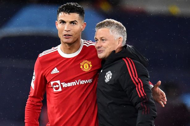 Manchester United manager Ole Gunnar Solskjaer (R) celebrates with Cristiano Ronaldo after the UEFA Champions League group F soccer match between Manchester United and Villarreal CF