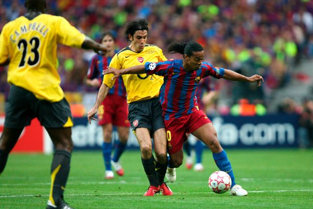 Robert Pires of Arsenal and Ronaldinho of Barcelona during the Champions League Final match between Barcelona and Arsenal at Stade de France, Paris, France on May 17th 2006