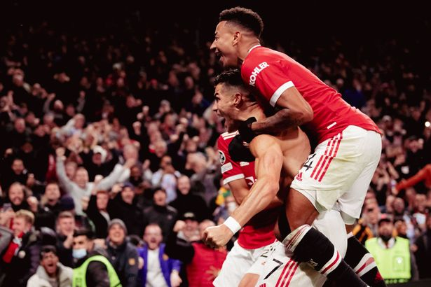 Cristiano Ronaldo of Manchester United celebrates scoring a goal to make the score 2-1 with Jesse Lingard during the UEFA Champions League group F match between Manchester United and Villarreal CF at Old Trafford on September 29, 2021 in Manchester, United Kingdom.