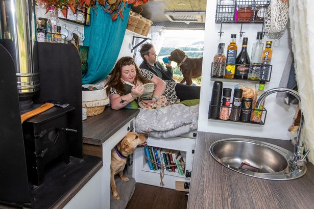 Victoria and Scott with their converted van and two dogs