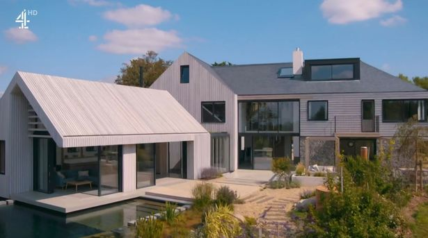 The completed house looks stunning with a natural pond to swim in and an open-panning lounge