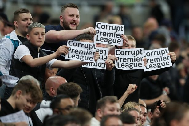 Newcastle United v Leeds United - St James' Park, Newcastle, Britain - September 17, 2021 Fans with signs before the match