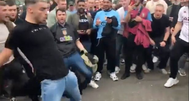 Aston Villa fans doing the 'Siu' celebration