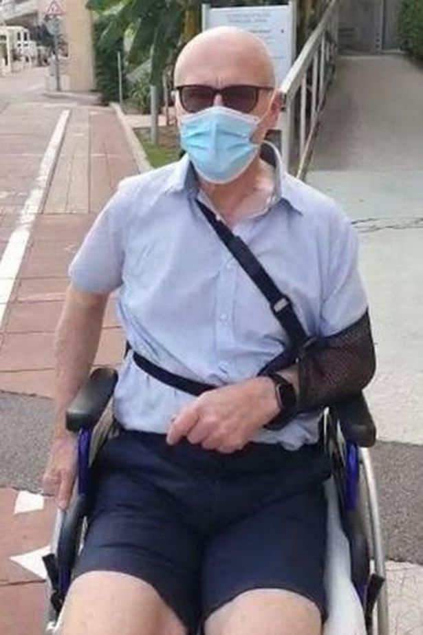 John Caudwell in a wheelchair after the incident