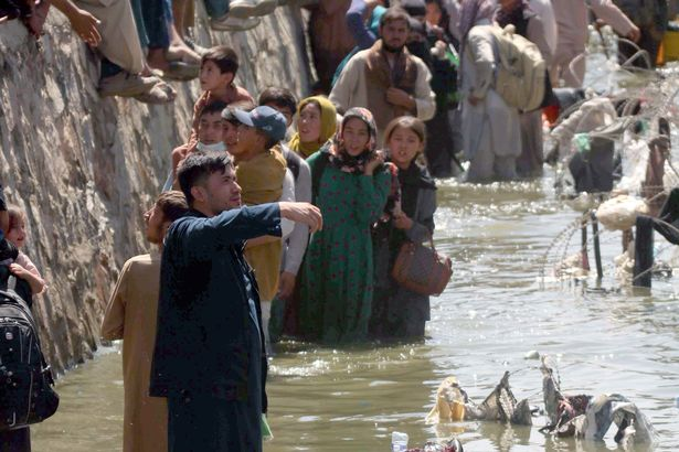 People had to walk through a sewer to reach Kabul Airport