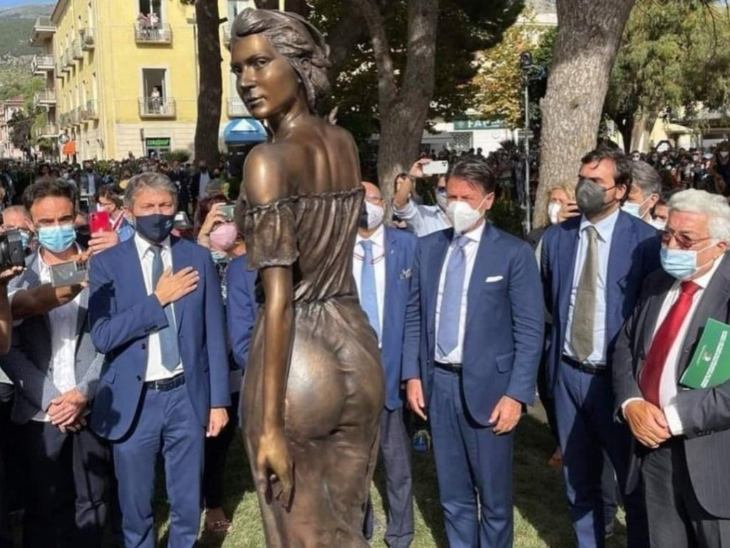 Bronze statue of woman in see-through dress sparks sexism row after it's unveiled by group of men in Italy