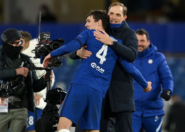 Thomas Tuchel (2R) congratulates Chelsea's Danish defender Andreas Christensen after the UEFA Champions League second leg semi-final football match between Chelsea and Real Madrid