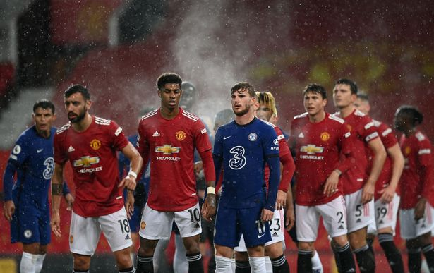 Marcus Rashford of Manchester United looks on with Timo Werner of Chelsea during the Premier League match between Manchester United and Chelsea at Old Trafford on October 24, 2020 in Manchester, England