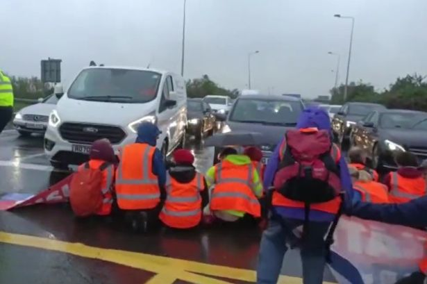Climate change activists block M25 near Heathrow as police drag them off road