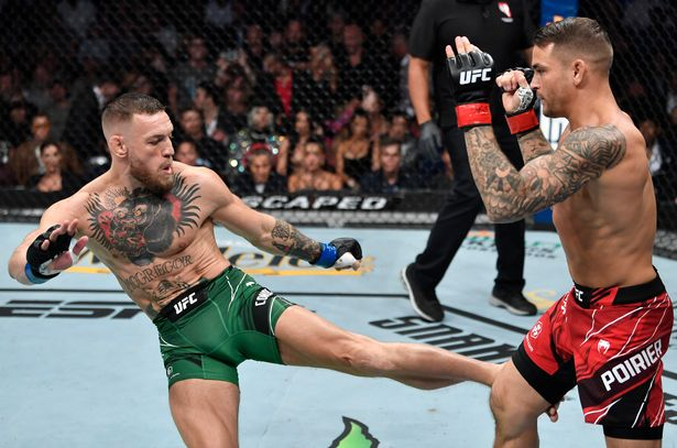 Conor McGregor of Ireland kicks Dustin Poirier in their welterweight fight during the UFC 264 event at T-Mobile Arena on July 10, 2021 in Las Vegas, Nevada.
