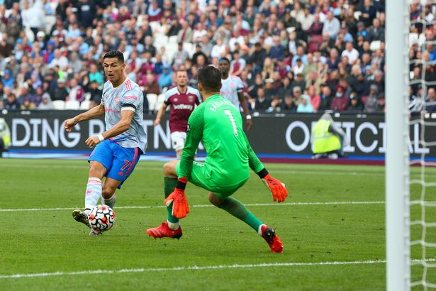 Cristiano Ronaldo of Manchester United has a shot at goal during the Premier League match between West Ham United and Manchester United at London Stadium on September 19, 2021 in London, England.