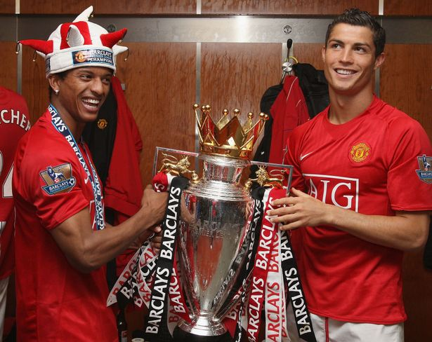Nani and Cristiano Ronaldo of Manchester United celebrate with the Premier League Trophy in the dressing room after the Barclays Premier League match between Manchester United and Arsenal at Old Trafford on May 16 2009, in Manchester, England