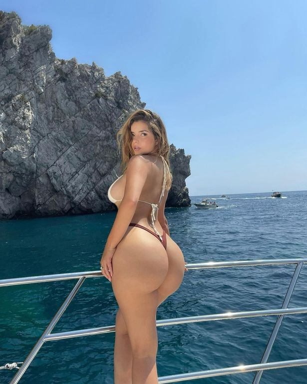 Demi Rose dons tiny thong bikini as she parades curves in sun-soaked display