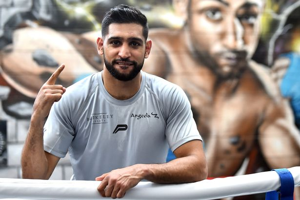 Amir Khan poses for a photographs as he takes part during a training session at Amir Khan Academy on June 19, 2019 in Bolton, England.