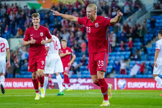 Norway's forward Erling Braut Haaland (R) celebrates scoring during the FIFA World Cup Qatar 2022 qualification Group G football match between Norway and Gibraltar in Oslo, on September 7, 2021. - Norway OUT