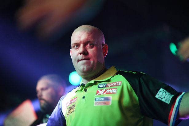 : Michael Van Gerwen makes his way towards the board during Day Three of the PDC Players Darts Championship at Butlins Resort on November 24, 2019 in Minehead, England.