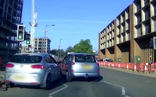 The woman got out of her car after the other driver tried to overtake her