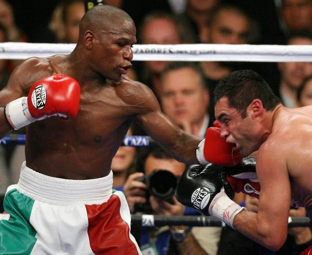 Floyd Mayweather defeats Oscar de la Hoya during their WBC Super welterweight world championship fight in May 2007 taking the title