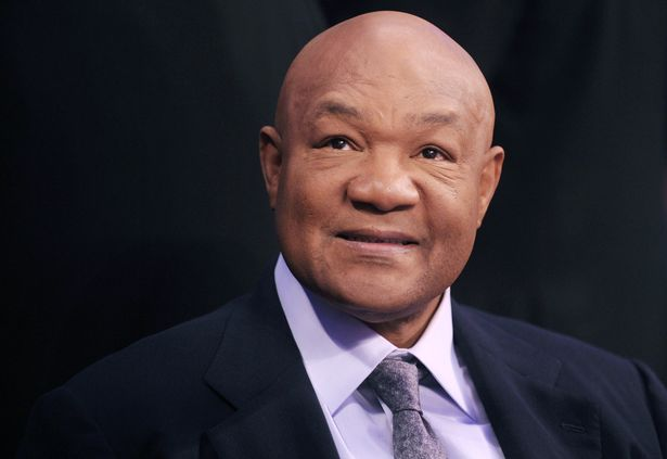 Former two-time world heavyweight champion George Foreman smiles during the 'Fists of Gold' boxing event in Macau on April 6, 2013