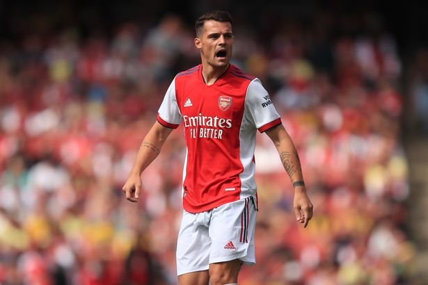 Xhaka wears Arsenal pitch while performing