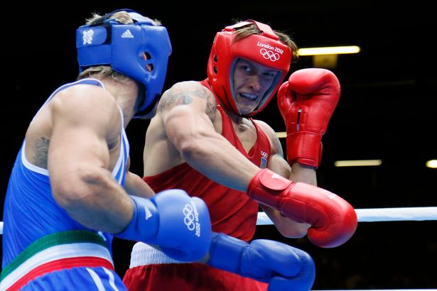 Oleksandr Usyk of the Ukraine (in red) defends against Clemente Russo of Italy (in blue) during the Heavyweight (91kg) boxing final of the 2012 London Olympic Games at the ExCel Arena August 11, 2012 in London. Usyk won gold on a 14-11 points decision