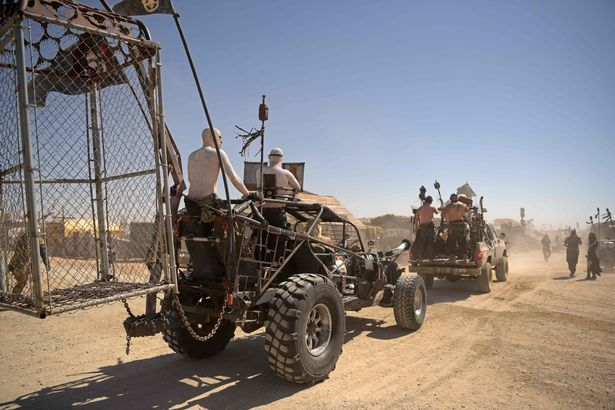 Attendees drive their ATV vehicles during Wasteland Weekend festival