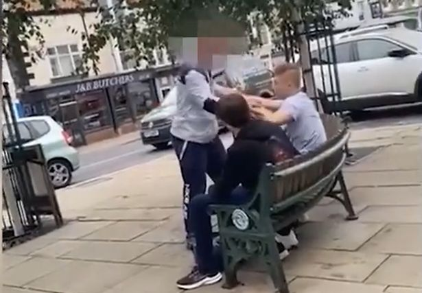 The man can be seen aggressively shouting at 16-year-old Alex Williams up-close, while the teen sits on a bench.