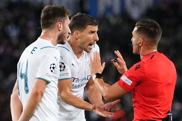 Ruben Dias berates the referee